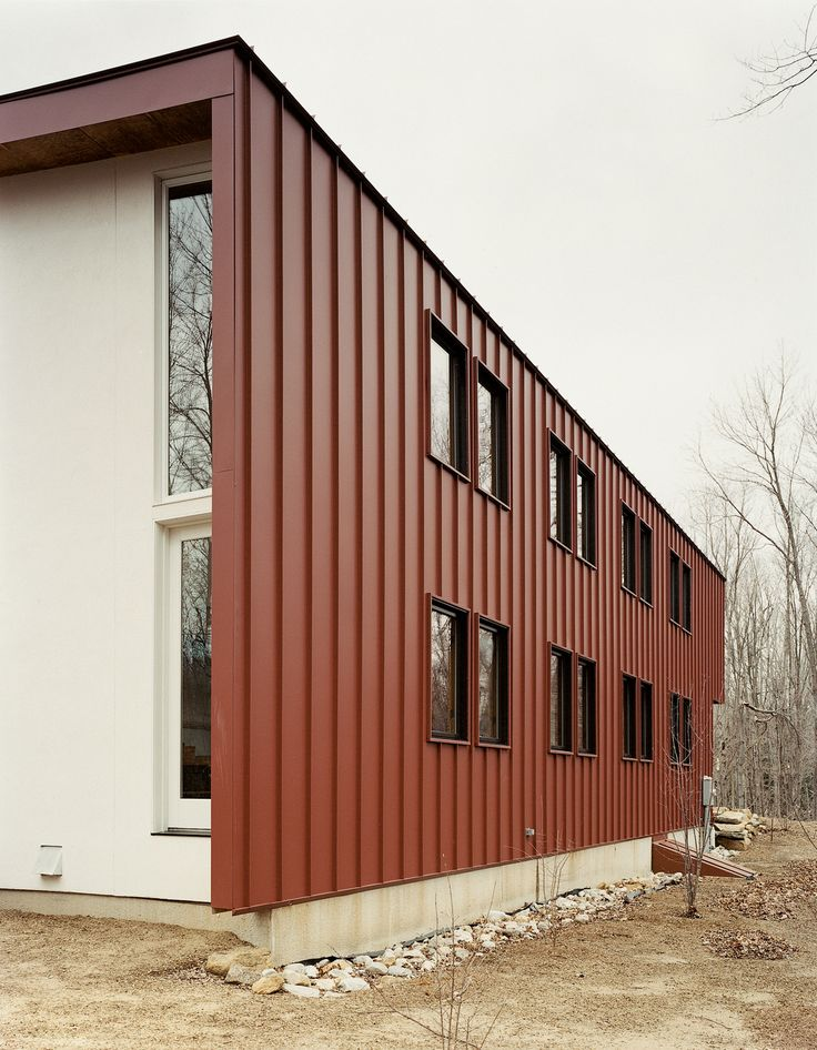 """To avoid constant maintenance issues—after all, """"durability is part of sustainability,"""" Gaffney states—the roof is clad in standing seam metal and the siding is composite plastic decking, rather than easily weathered wood."""