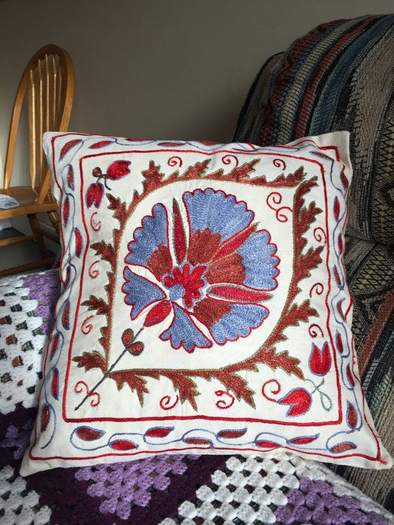 """True to the """"needle"""" origin of the Persian word suzani, these pillows are embroidered with traditional floral motifs in richly colored patterns that define this historic style. Suzani comes from the Persian word for needle, and the word refers to embroidered hangings or fabric coverings, generally a meter and a half wide (4-5) but sometimes much more. The birthplace of suzani is in what is now Uzbekistan, the area along the Silk Roads that interconnected the cultures of Europe, Turkey and…"""