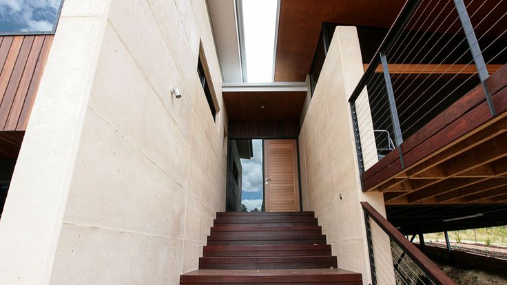 Rammed Earth walls, spotted gum cladding,