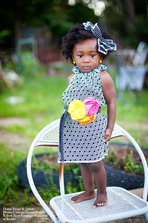 Adorable African girl in an cute dress :-)