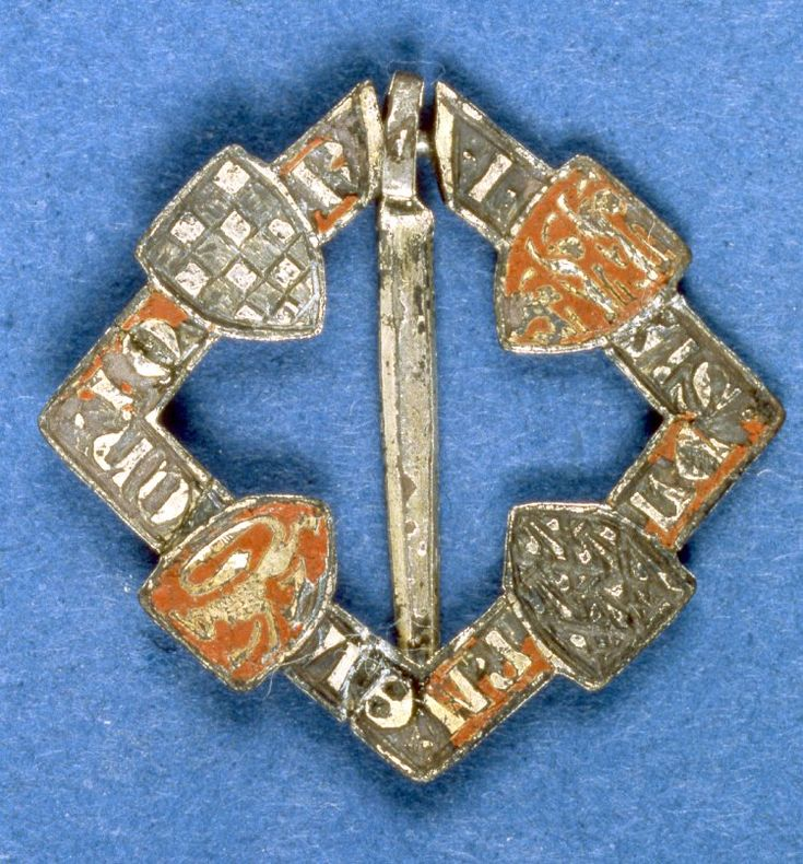 Square brooch, silver, 1275-1325. On each side four enamelled shields alternating with an inscription. Arms identified as Clifford, Clare, Warenne, England, France and FitzAlan.
