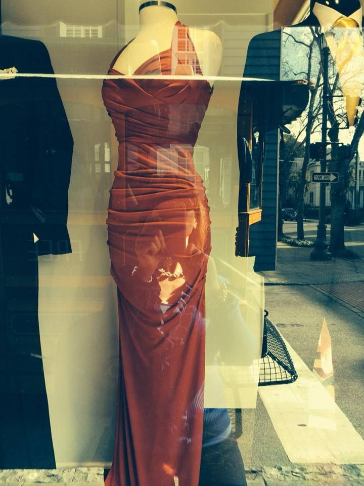 Sorry for the reflection in the photo, but this was taken in the shop window at Berlin's department store on the corner of King and Broad in Charleston. If you will recall, in The Strangers on Montagu Street, Melanie's mother buys Mellie THE red dress for her 40th birthday party at the exact same store. And this is EXACTLY as I pictured it!! Hmm... #placesoftradd