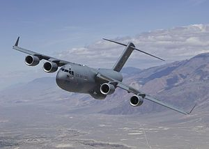 The Boeing C-17 Globemaster III is a large military transport aircraft. The C-17 commonly performs strategic airlift missions, transporting troops and cargo throughout the world; additional roles include tactical airlift, medical evacuation and airdrop duties.