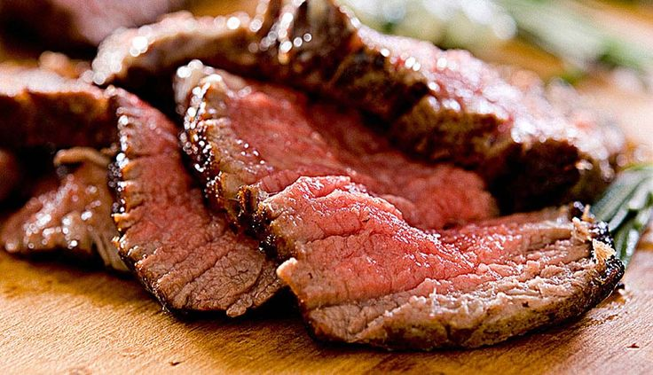 SMOKED BEEF TENDERLOIN STEAKS WITH BLUE CHEESE AND PEPPERCORN BUTTER