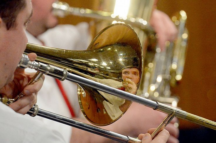 """The Schenectady County Public Library kicked off its Beat the Snow Winter Concert Series 2016 on Sunday, January 10, 2016. Ryan Pangburn is reflected in his trombone with the brass quintet, """"Route Fifty 5."""""""
