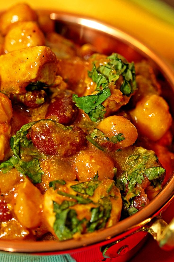 For this Chicken Chickpea Masala I simmer the chickpeas and red beans in onions, chopped tomatoes, garlic, chilies, my chana masala spice blend and garam masala.
