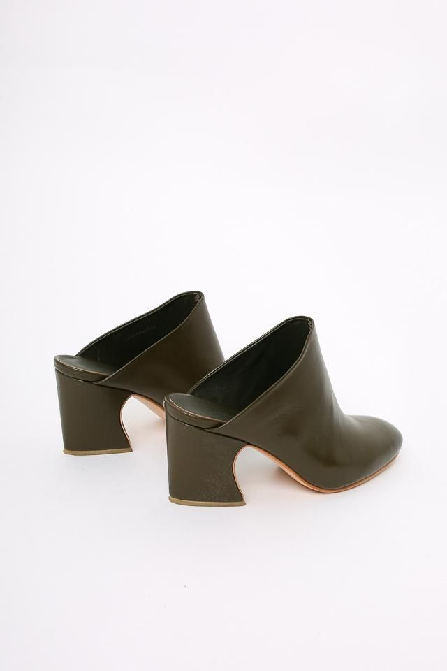 5c999ea3e Smooth kidskin mule in deep olive green. Features minimal seamless upper