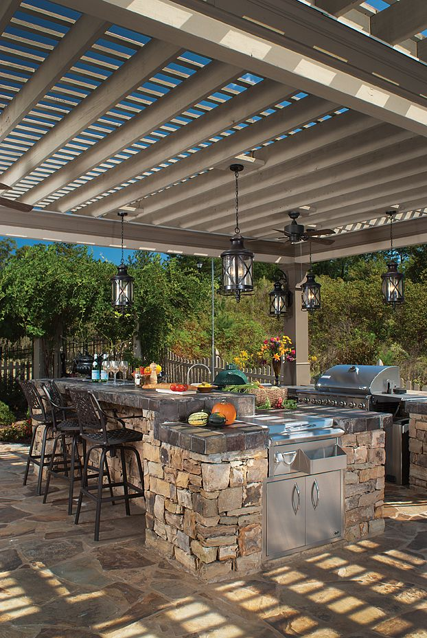 Expansive Portico Features Lighting Ceiling Fans And A Good Amount Of Shade That Keep This Chef Calm Cool And Collected Outdoor Patio Designs Outdoor Pergola