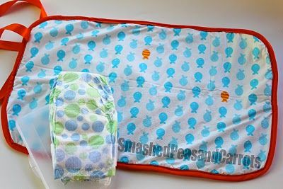portable baby changing mat made out of a vinyl tablecloth