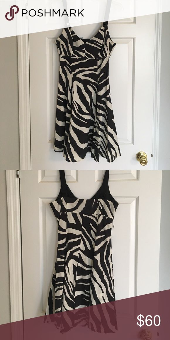 Guess zebra print dress Black and white zebra print dress. Adjustable straps and zipper back. Worn once and dry cleaned after. Guess Dresses