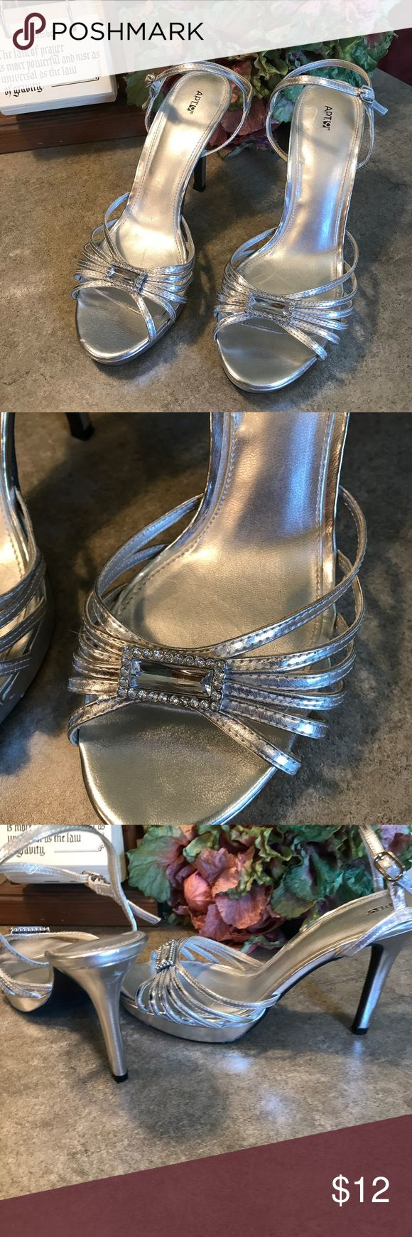 "APT. 9 These lovely Silver heels are ready to party. Used but worn only a few times. Great for the Prom!! One heel does have a small scuff mark. Unnoticeable heels are 4"". The size is not marked on shoe the store did not have the box but said they were a size 8 Ladies. Shoes Heels"