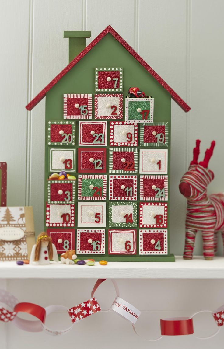 This looks like a ton or work but darn if it isn't cute!  Too bad we don't have a mantle... How to Make a Painted Advent House #advent #christmas