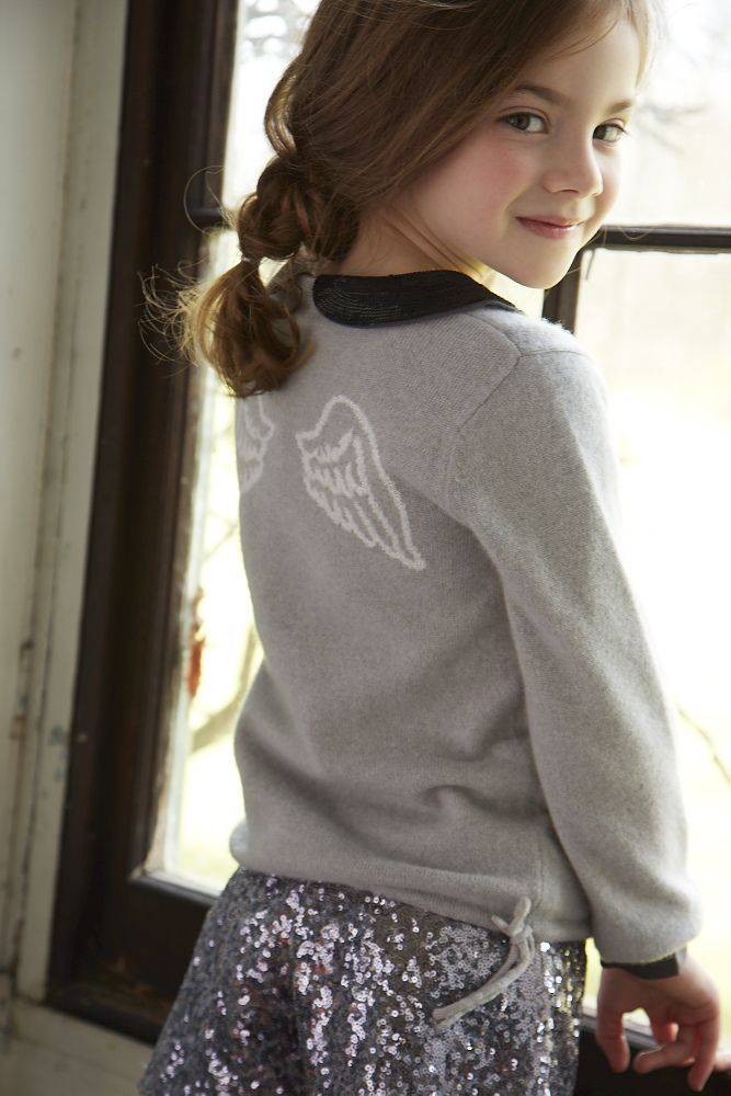 This cashmere sweater features our iconic Angel Wings.
