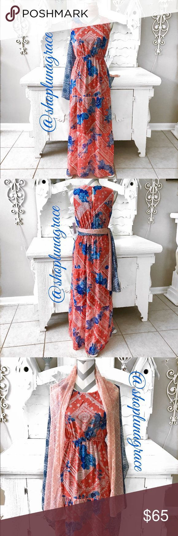New🌞 Floral Maxi Dress Hello warm weather days & nights! This maxi dress is gorgeous colors of coral/blues. Gathered under the bust with a tier beneath & another lightly gathered tier. I found the scarf, wrap separately and it's stunning with the dress! Use it around your neck, as a sash around your waist or wear it as a wrap on a cool night! Has an under lining. NWT En Focus Dresses Maxi
