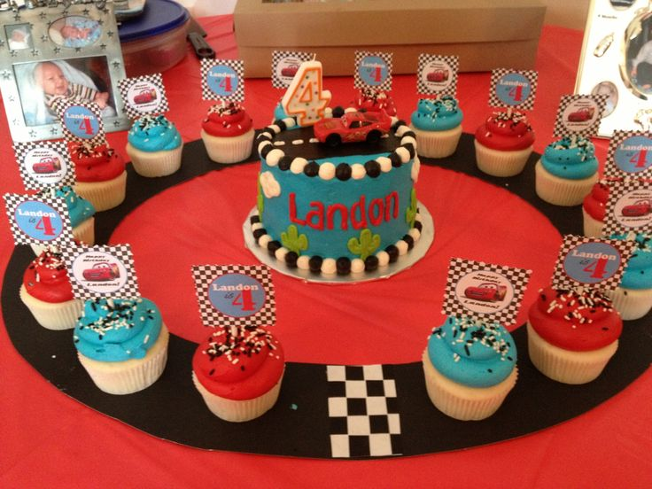 "Disney cars party custom cake and cupcakes on a ""race track""!"