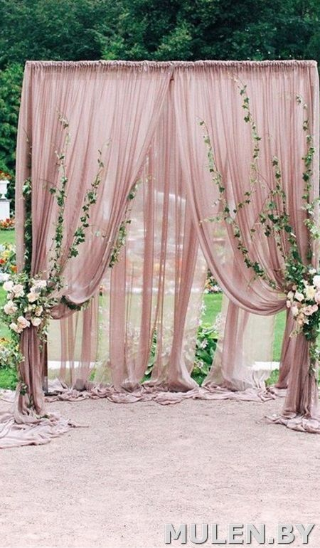 outdoor wedding ceremony  with blush drapery and foliage