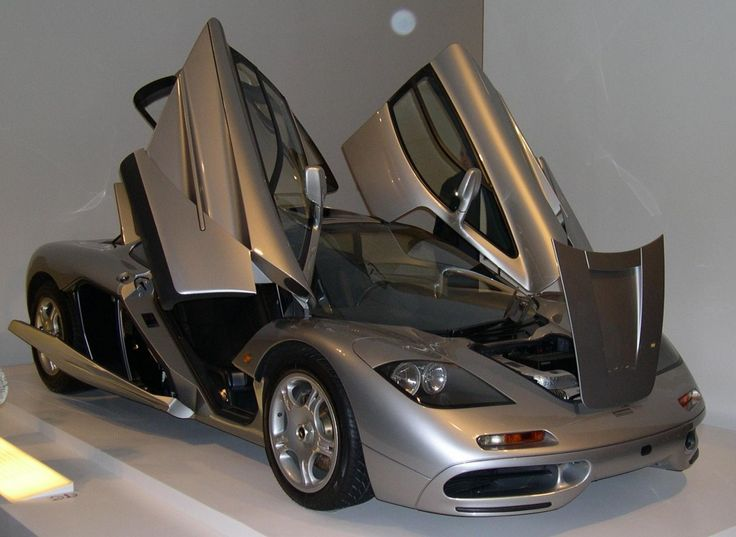 McLaren F1  Released in 1992 the F1 was remarkably ahead of its time. McLaren had taken great pains to reduce the weight and ensure safety and stability at high speeds, even lining the engine bay with gold as the world's most rarefied heat insulator. As a result, the car was able to achieve its now legendary 242mph top speed and fetch a price tag in excess of £1 million today.