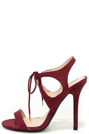 """Life in the fast lane can be that much more exciting when the Forever Young Wine Red Lace-Up Heels are involved! Velvety vegan suede covers a chic, single toe strap and cutout ankle fashioned with rounded laces and gold aglets. 4.25"""" wrapped stiletto heel. Cushioned insole. Nonskid rubber sole. Available in whole and half sizes. Measurements are for a size 6. All vegan friendly, man made materials. Imported."""