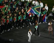 LONDON, ENGLAND - JULY 27: Caster Semenya of the South Africa Olympic athletics team carries her country's flag during the Opening Ceremony of the London 2012 Olympic Games at the Olympic Stadium on July 27, 2012 in London, England.