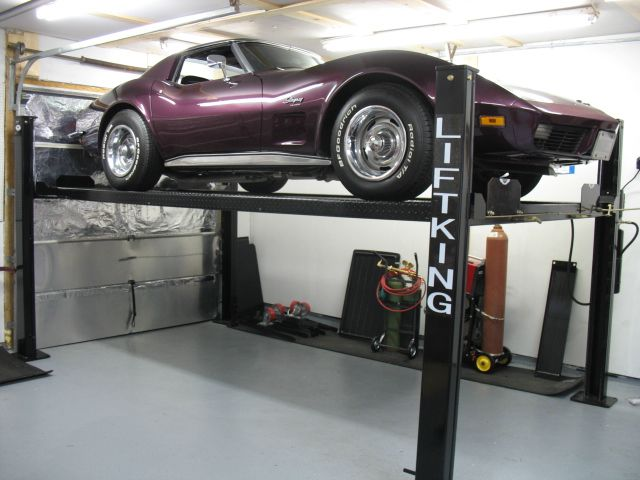 From motorcycle lifts to two car storage; auto lifts can be custom installed to help you reach a better organized and maintained garage area. Description from dreamgaragemakeovers.com. I searched for this on bing.com/images