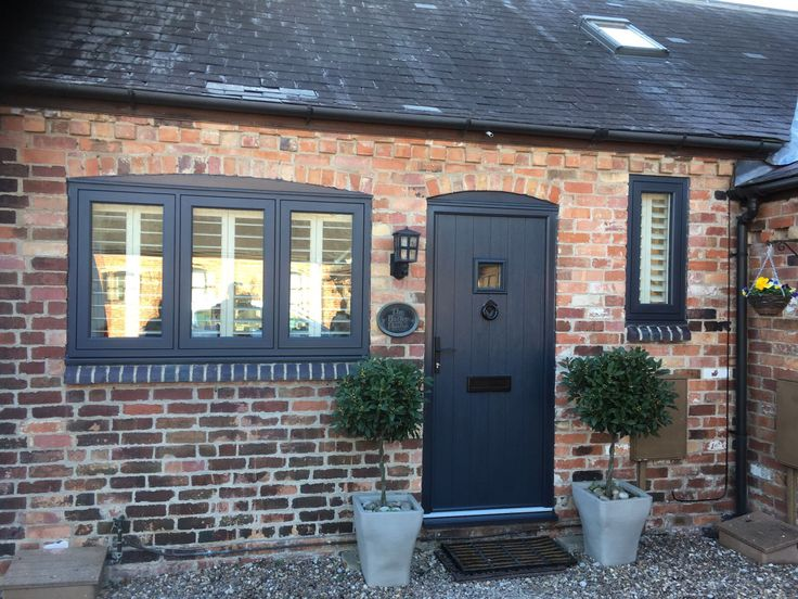 A Flint square @SolidorLtd composite door in a modern anthracite grey to match the windows with traditional black hardware. Installed in Gamston, Nottingham. For a free quotation call us on 01158 660066 visit http://www.thenottinghamwindowcompany.co.uk or pop into our West Bridgford showroom.