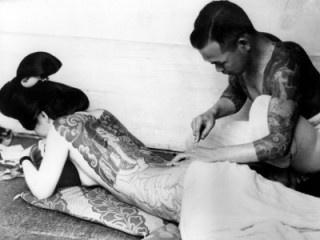 Calligraphic tatoo art administered to a  geisha