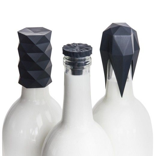 The GIR Wine Bottle Stopper 3 Piece Set hides a silicone cork inside a tall and beautiful outer form, allowing the bottle to stand upright or lie flat in a fridge. Three silicone rings around each cork provide a superior seal for any size bottle.