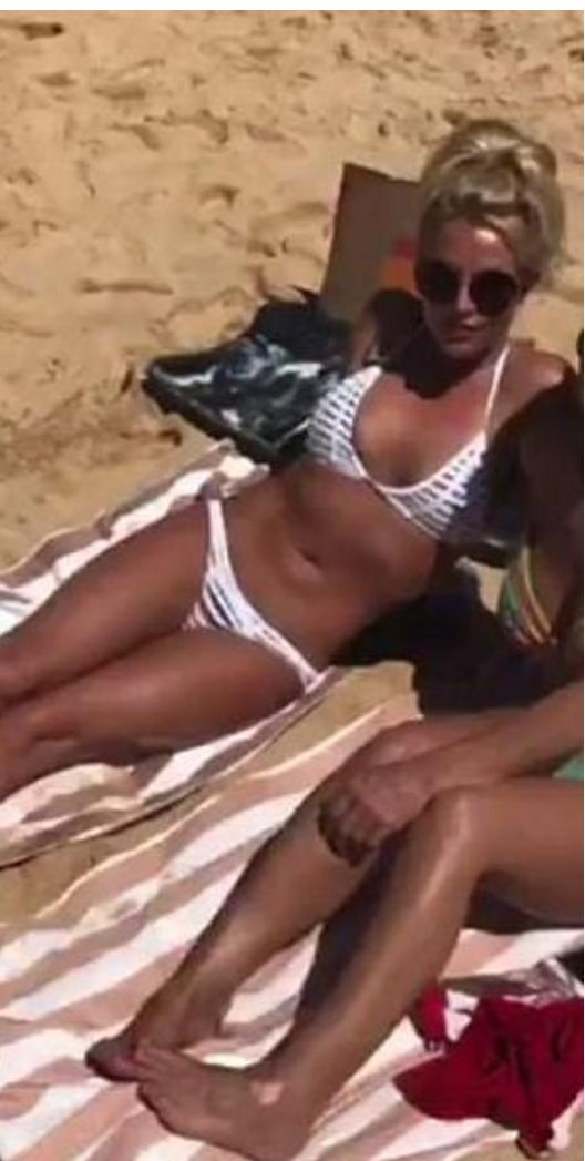 Who made  Britney Spears' white striped bikini?