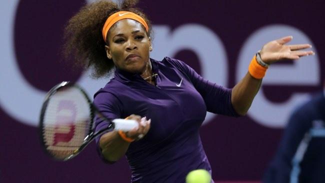 Serena Williams of the U.S. returns the ball to Poland's Urszula Radwanska on the fourth day of the WTA Qatar Ladies Open tennis tournament in Doha, Qatar, Thursday, Feb. 14, 2013. (AP Photo/Osama Faisal)