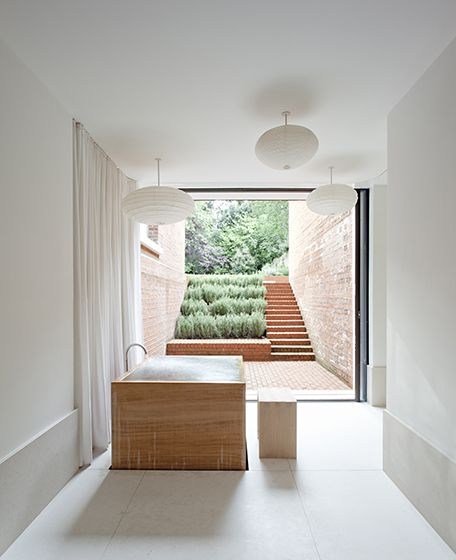 bathroom and underground patio - Steeles Road House in London by Sevil Peach