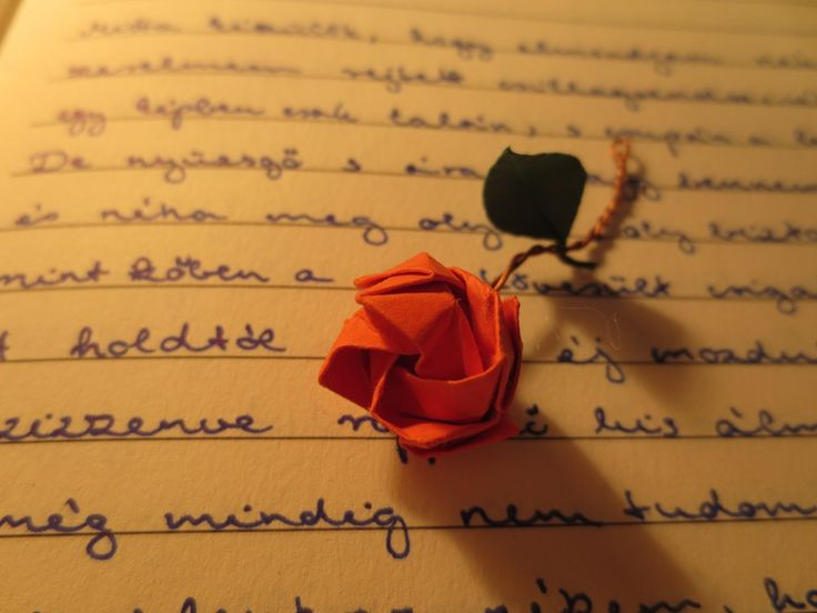 tiny origami rose on a poem