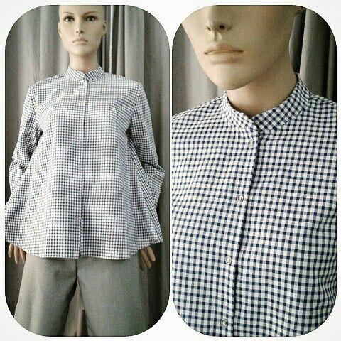 Camicia a quadretti bianco/bluette 100% cotone, collo alla coreana, svasata sul fondo, bottoni a pressione €78.