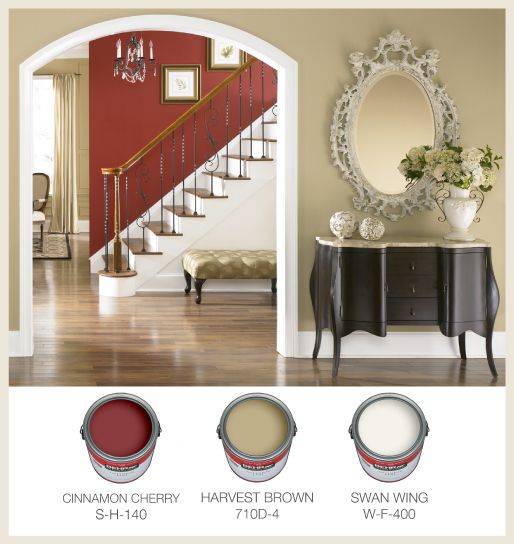 """Warm traditional interior paint color palette with """"Cinnamon Cherry"""" red, """"Harvest Brown"""" taupe, & """"Swan Wing"""" white trim from Behr."""