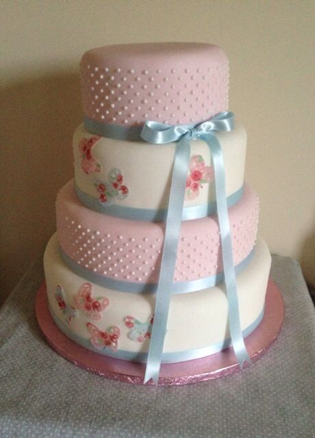 Sugar pearl and floral butterfly wedding cake by Boutique Bakehouse www.boutiquebakehouse.co.uk
