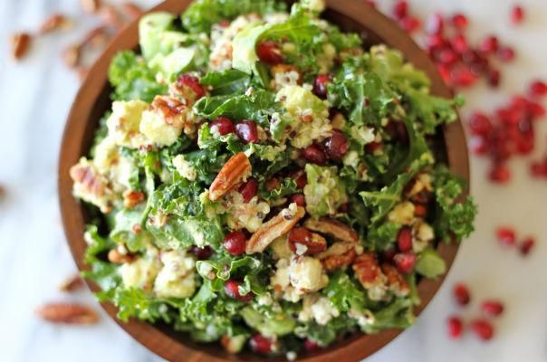 Kale and quinoa salad with avocado, pomegranate seeds, pecans, goat cheese, and Meyer lemon vinaigrette