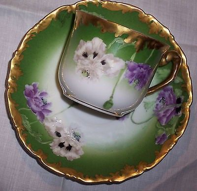 FEATURING AN ADORABLE ANTIQUE FRENCH LIMOGES PORCELAIN CHINA DEMITASSE AFTER DINNER COFFEE CUP AND SAUCER. MOST UNUSUAL AND BEAUTIFUL, IN AN ART NOUVEAU DESIGN, WITH HAND PAINTED PURPLE AND WHITE POPP