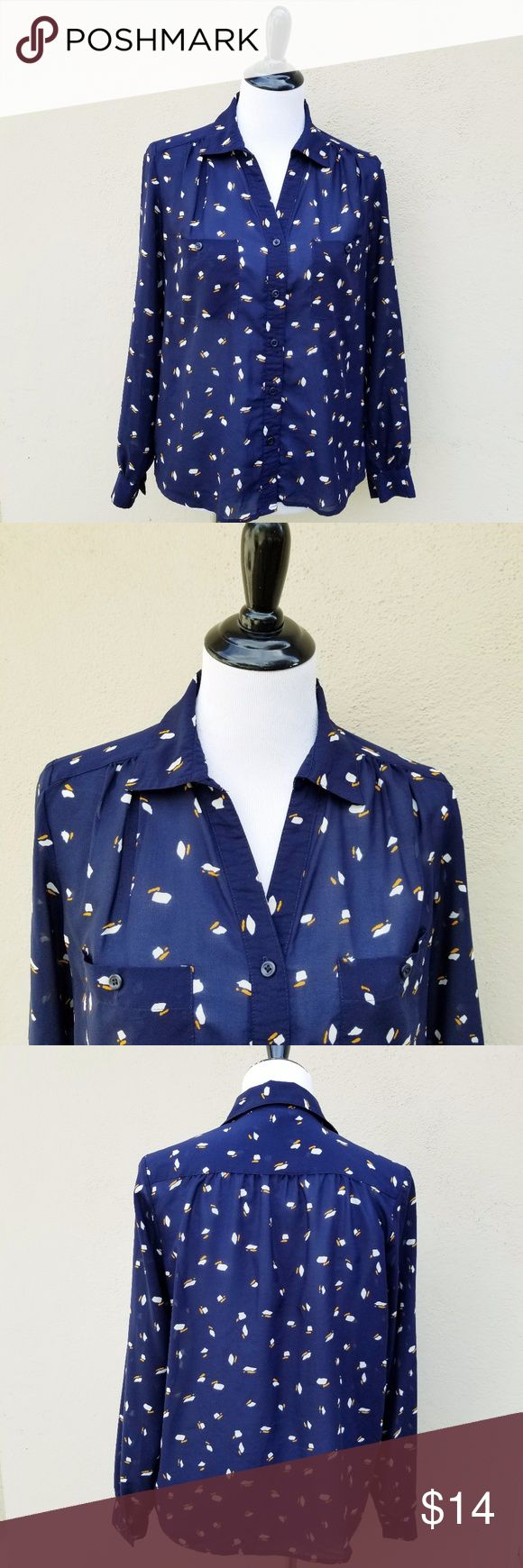 Sheer Navy Blue with Art Deco Pattern Button Up In Pristine Condition  This sheer navy blue with white and mustard yellow art deco pattern design button down has puckered sleeves and shoulders and is detailed with 2 front pockets.  100% polyester Forever 21 Tops Button Down Shirts
