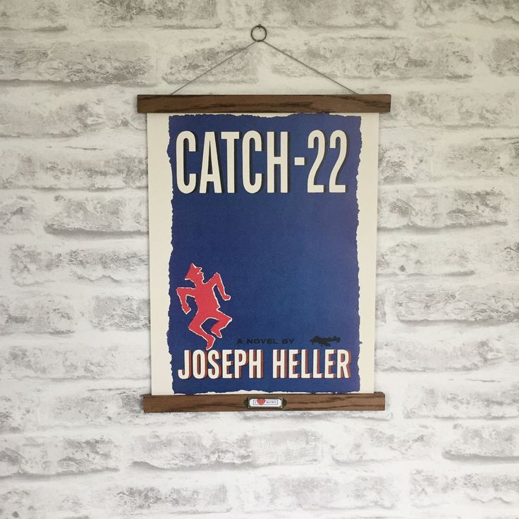 Perfect as a gift for a loved one! It also includes a matching split ring on a traditional waxed cotton cord ready for hanging. Reproduction of original design Catch 22 by Joseph Heller. This is a copy of the first edition cover from 1961. | eBay!