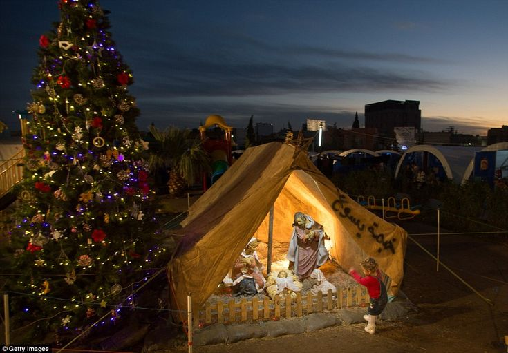 Eerie: A beautifully decorated Christmas tree and nativity scene provide a centre-piece for the sadness around them   Christmas in an Iraqi refugee camp: nativity scene set up by some of the thousands of Christians fleeing ISIS in this refugee camp in Erbil a tiny fraction of over 3 million 'internally displaced' - many in Kurdistan autonomous region pushed to breaking point by dropping temperatures