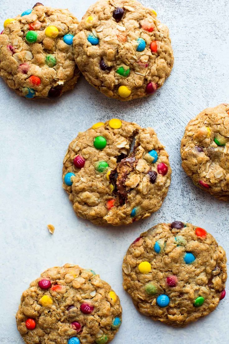 Peanut butter monster cookies with a Reese's peanut butter cup inside!! Recipe on sallysbakingaddiction.com