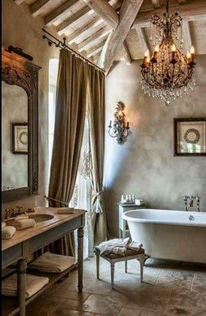 under counter towel shelf; bathroom feels open with clawfoot tub