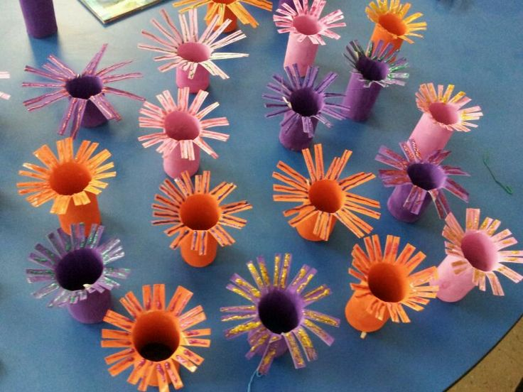 Sea anemones for our underwater VBS theme :-) Empty toilet paper tubes painted inside & out. Then cut and some glitter glue. Very easy to make :-)