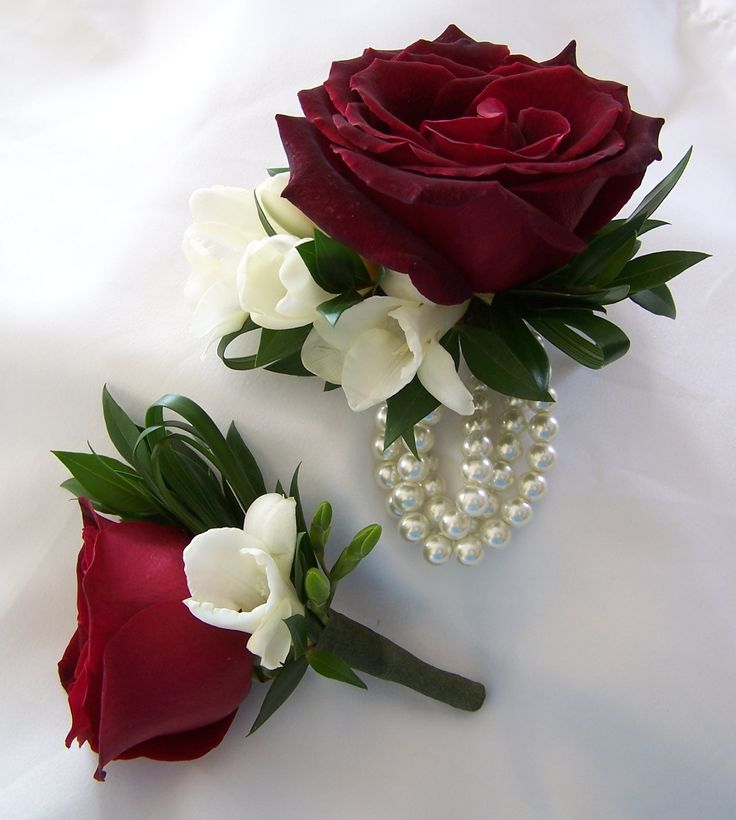 Boutonniere & Wrist Corsage: Roses, freesia, myrtle & lily grass
