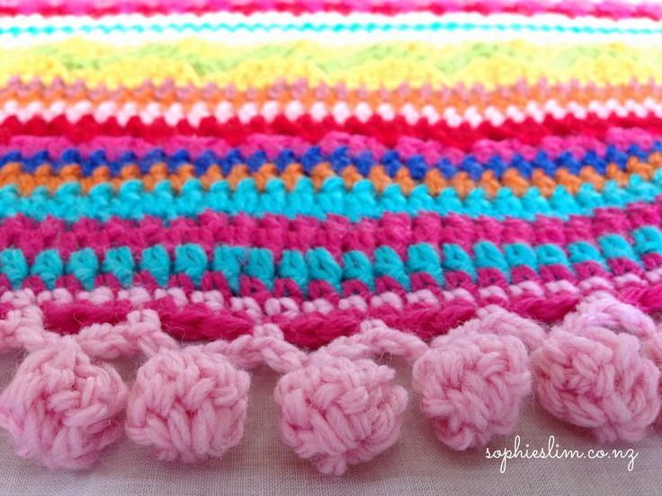 pom pom edging on crazy eclectic crochet blanket!