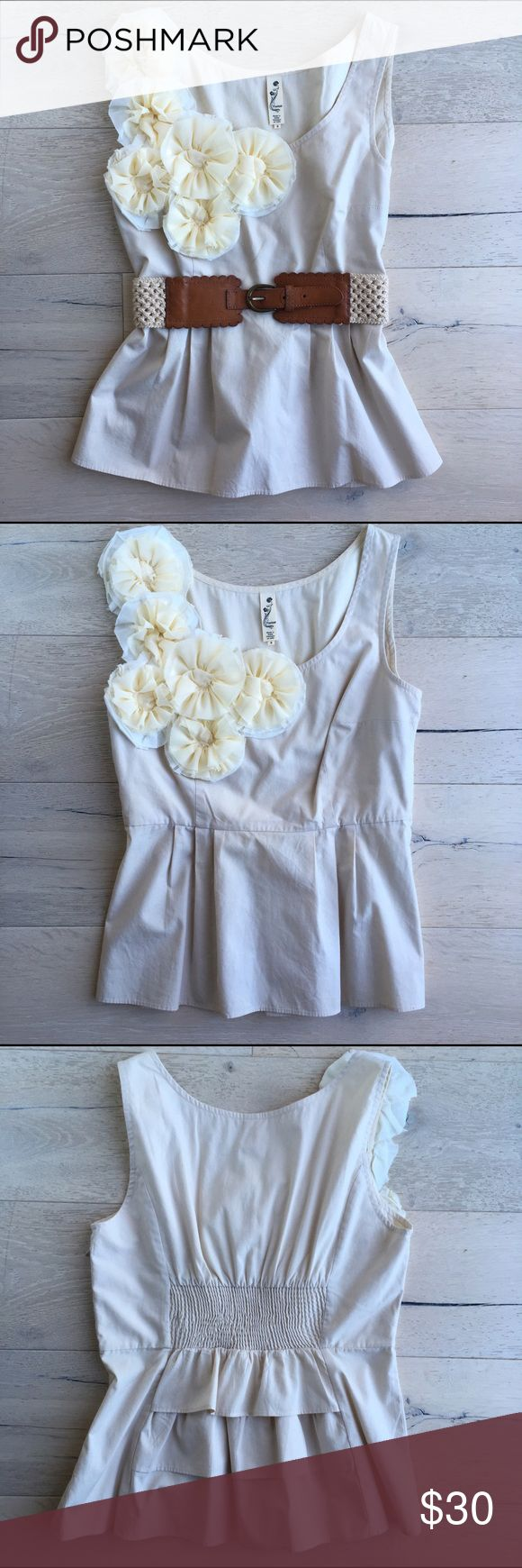 Anthropologie Women's Floreat Peplum Flower Top Anthropologie Women's Floreat Peplum Flower Top.  Size 6.  Top has beautiful detailing with six pale yellow and white flowers that cascade down the right shoulder.  Flattering peplum with smocked elastic back above the ruffle detail.  Belt not included in listing.  Comes from a smoke free, pet free home. Anthropologie Tops Blouses