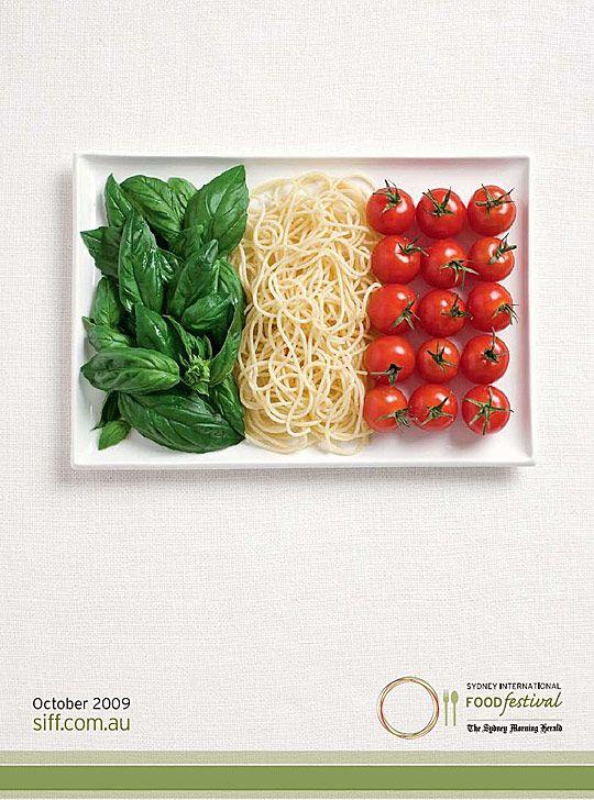 Italian flag made of food - pasta, tomatos and fresh herbs