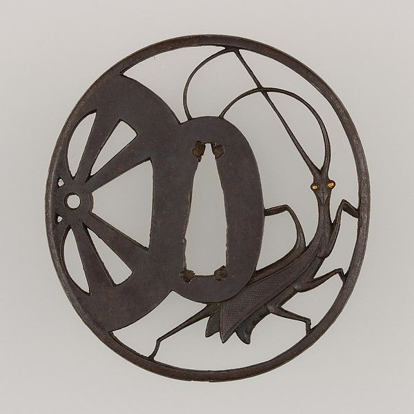 Tsuba, iron, gold, copper, depicting a praying mantis and a wheel. 19thC.