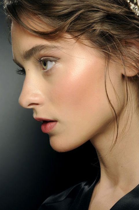 Spring Makeup Idea: Super-Coral Cheeks Blush is usually meant to be barely seen but we actually noticed the rich cheek color at Dolce & Gabbana—in a good way. To get that glow dust on a coral shade like Dolce & Gabbana Luminous Cheek Color in Rosebud Start from the hollows of the cheeks; move up to the temples. Sport the look with pinky-nude lip gloss and mascara. The result: so romantic.