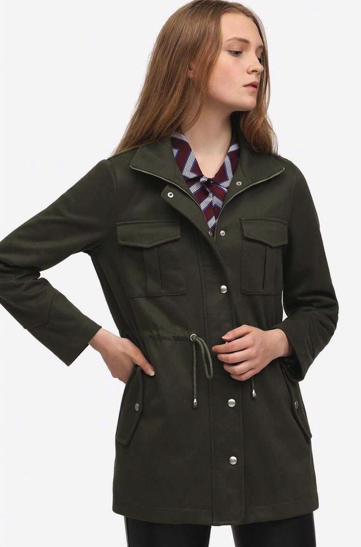 Dark green jacket with poppers and waist tie by Minspri Paris.