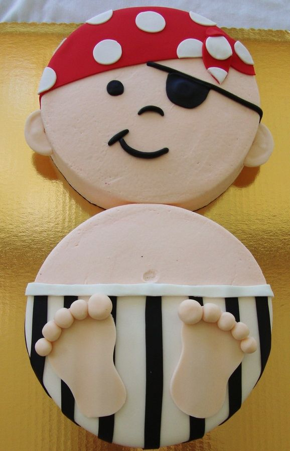 "This is a cake I made for a pirate theme baby shower, 2 10"" rounds iced in bc with fondant decor."